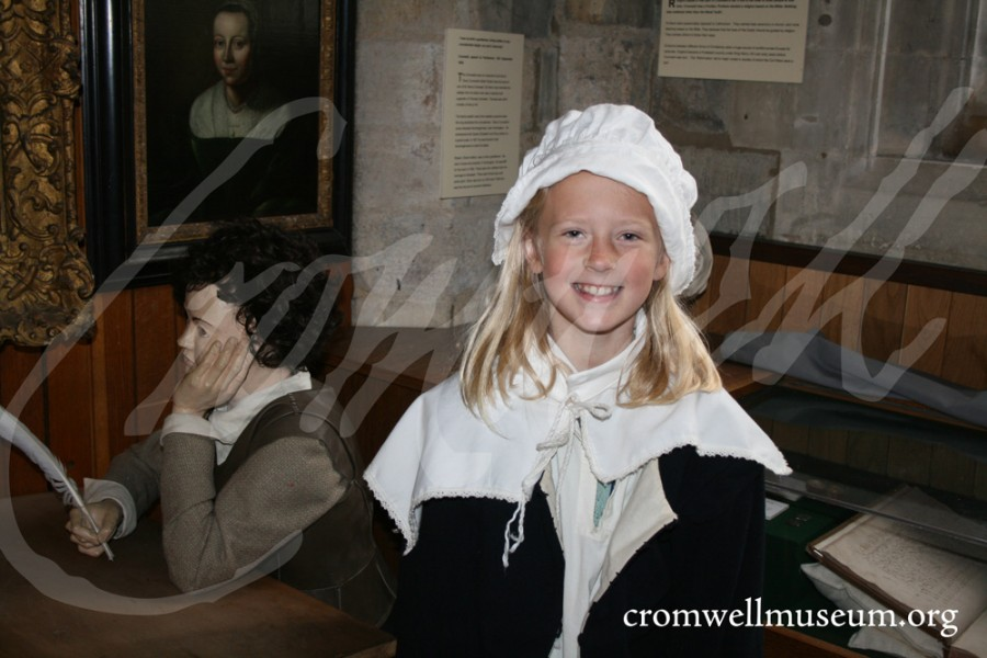 Child dressed in traditonal puritan costume